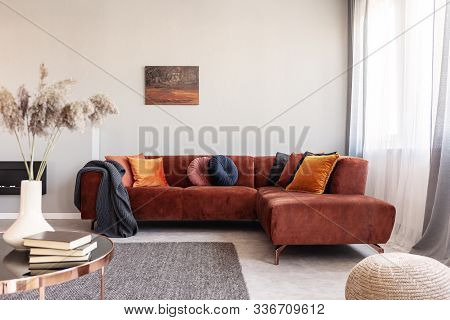 Real Photo Of Warm Color Cushions On A Red Couch Standing Next To The Window In Cozy Living Room Int