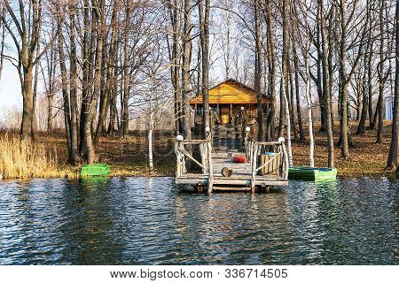 Bathhouse On The Lake With Its Jetty And Bath.