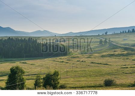 Landscape Of Grassland With Shinning Wire Line Cross Through The Field,beautiful Alpine Meadow With