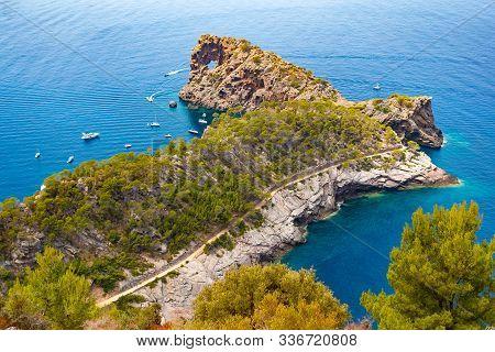 Punta De Sa Foradad And Boats At Gulf In Mallorca, Spain