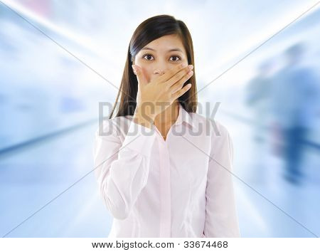 Asian woman with big surprise expression, hand covering mouth