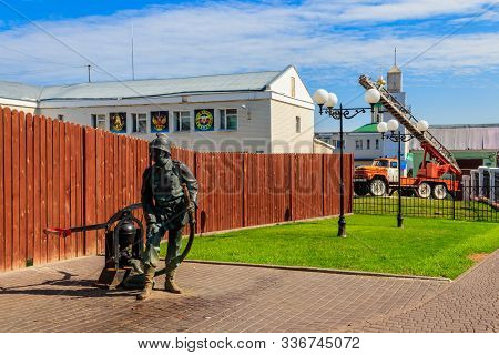 Vladimir, Russia - August 13, 2019: Monument To Firefighter In Front Of The Local Fire Station In Vl