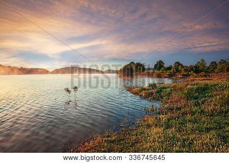 Lago di Bilancino, Barberino del Mugello, Florence, Italy: landscape at dawn of the picturesque lake in the Tuscan hills poster