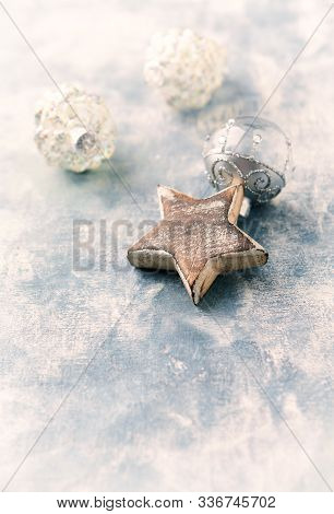 Wooden Christmas Star On Rustic Background. Close Up. Copy Space.