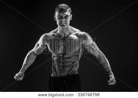 Very Brawny Guy Bodybuilder Posing. Beautiful Sporty Guy Male Power. Fitness Muscled Man. Roar