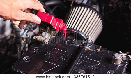 Hand Of Technician Service Check Battery And Turn Battery Screw Loose In Garage