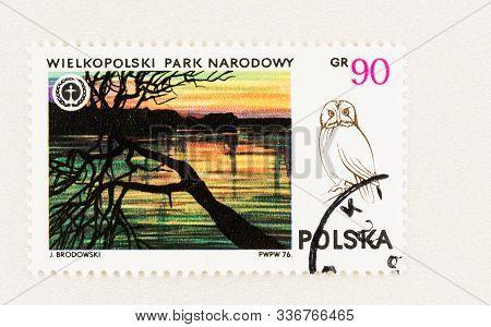 Seattle Washington - October 9, 2019: Polish Postage Stamp With Wielkopolski National Park And Owl I