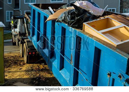 Dumpster, Recycle Waste And Garbage Bins Near New Construction Of Appartment Houses Building