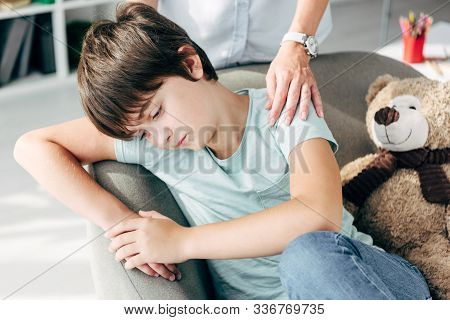 Cropped View Of Child Psychologist Hugging Sad Kid With Dyslexia