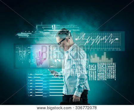 Young Man Using Smartphone . Futuristic User Interface Data And Information.
