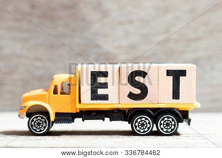 Truck Hold Letter Block In Word Est (abbreviation Of Established, Estimated, Eastern Time Zone, Expr