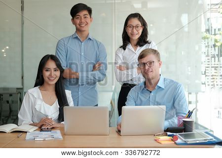 Asian Executive Businessman Businesswoman Man Woman Smiling At Workplace. Business  Team