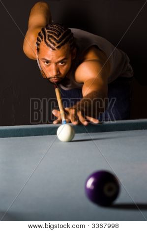 African American Male Lining Up A Pool Shot