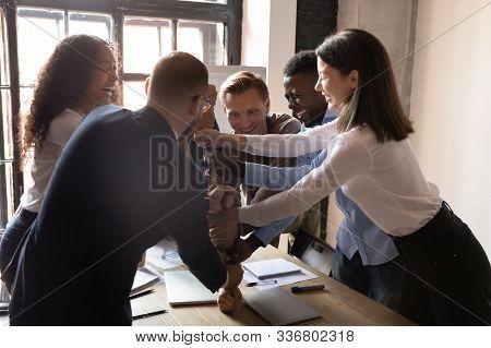Laughing Multiracial Team Enjoying Teambuilding Activity At Office.