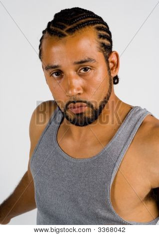 African American Male With Cornrow Haircut Looking Serious