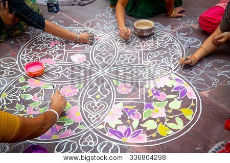 Hands Of Girls Making Rangoli - Indian Mandala. Indian Tourism. Indian Traditional Culture, Art And