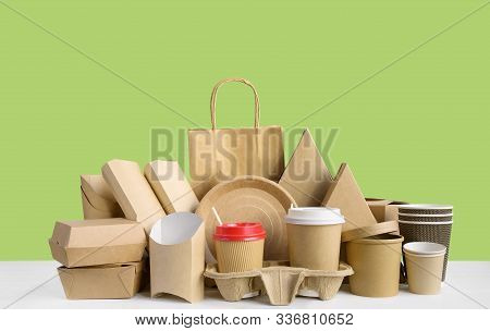 Fast Food Packaging From Eco Friendly Paper And Recycled Cardboard Isolated On Green Background. Foo