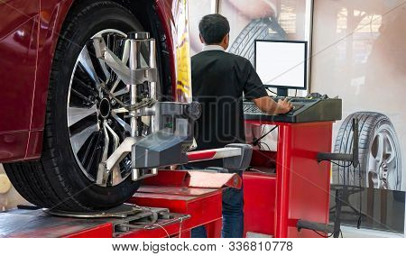 Wheel Alignment ,car On Stand With Sensors On Wheels For Wheels Alignment Camber Check In Workshop O