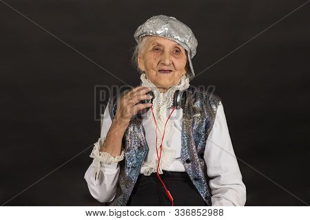 Vintage Old Woman In Glitter With Headphone
