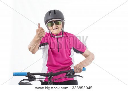Elderly Woman In Pink Shirt With A Bike