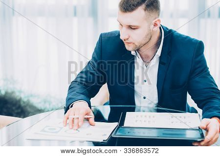 Corporate Lifestyle. Confident Successful Business Man Working With Document At Office.