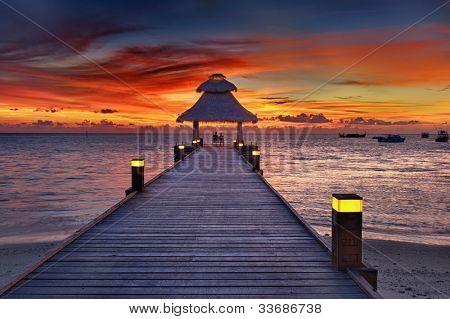 Awesome vivid sunset over the jetty in the Indian ocean, Maldives. HDR