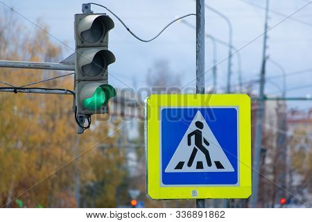 Old Traffic Light With Green Signal And Road Sign Pedestrian Crossing In Russia