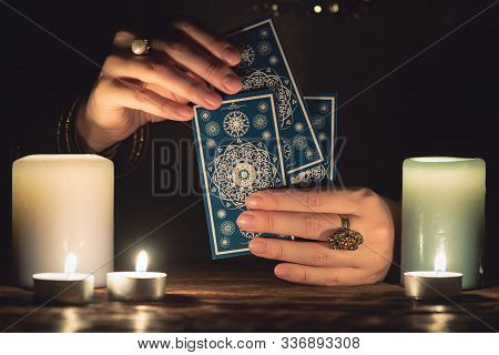 Fortune Teller With Tarot Cards In Hands Close Up. Future Reading Concept.