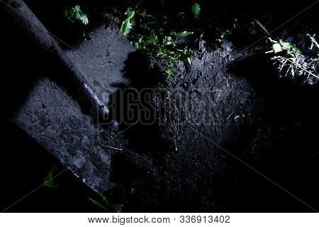 Dirty Old Shovel In Dark Trench. Digging Grave By Candlelight. Mystical Night Scene