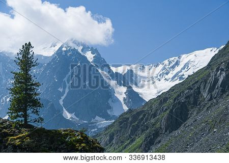Rocks Under Blue Sky With Clouds. Mountain Hiking, Summer Tourism