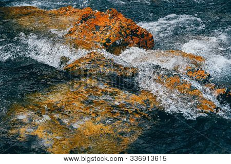 Mountain Stream With Yellow Stones. Rapid Flow Of River, Boiling Water