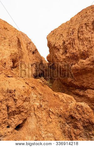 Red Canyon In Hills. Soil Erosion Following Drought, Climate Change And Formation Of Gullies. Lack O