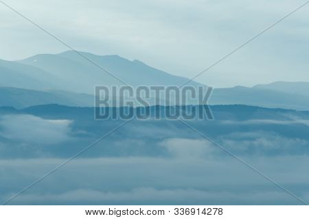 Gentle Hills In Bluish Haze. Soft Light In Early Morning, Silhouettes Of Mountains