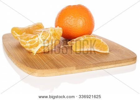 Group Of One Whole One Half Three Pieces Of Fresh Orange Mandarin On Bamboo Cutting Board Isolated O