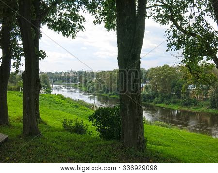 Summer Panorama With Trees, River And View Of Distant Church