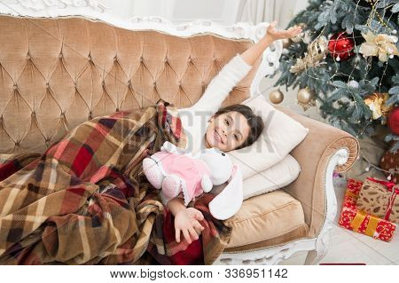 Christmas Eve. Dreaming About Christmas Miracle. Small Cute Girl Dreaming About Christmas Gift. Happ