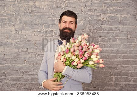 Spring Style. Womens Day Is On March 8. Spring Gift. Bearded Man Hipster With Flowers. Love Date. In