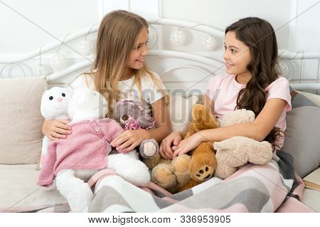 Soulmates Concept. Sisters Sharing Toys. Sisters Best Friends. Kids Play Toys In Bed. Little Girls S
