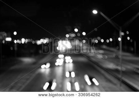 Defocused Speed Background. Blur Night Life. Illumination. Abstract Urban Night Light Defocused Back