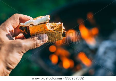 Having A Smore Over The Fire In The Summer