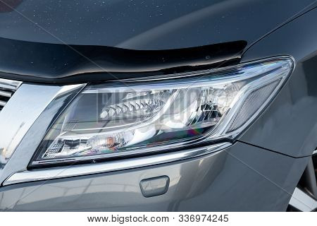 Front Headlamp View Of Gray Used Car Stands In The Auto Showroom Sale After Washing And Polish With