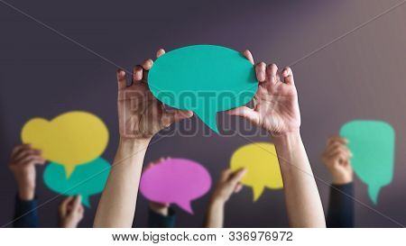 Freedom Of Speech Concept. Group Of People Protesting Or Making Campaign With A Blank Speech Bubble.