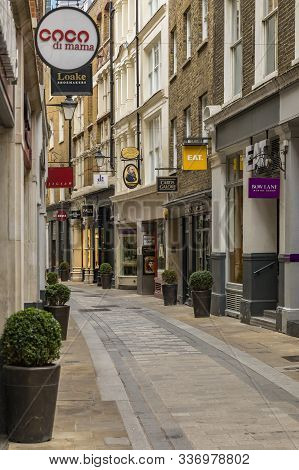 London, England - January 14, 2018: View Down Quaint Empty Bow Lane With Restaurants And Stores, Par