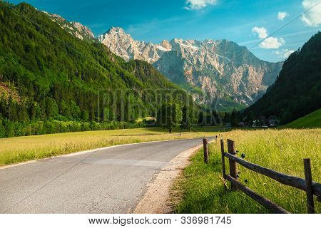 Fantastic Spring Alpine Landscape, Green Flowery Meadows And Snowy Mountains With Blue Sky, Logar Va