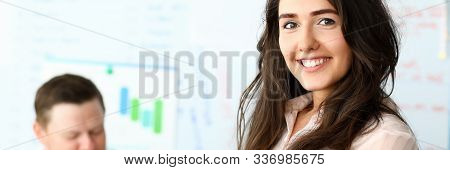 Portrait Of Attractive Woman Standing In Modern Corporation Office And Looking At Camera With Gladne