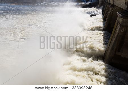 Water Drains From The Reservoir Creating Pillars Of Water Vapor And Foam. A Hydroelectric Power Stat