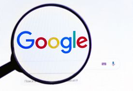 Google Logo On The Screen. The Official Website Of Google.com.