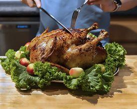 Roast Capon (turkey,chicken) On The Kitchen Table. Thanksgiving Christmas, New Year Family Celebrati