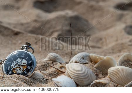 Antique Pocket Watch And Shells In Sand On The Beach And Copy Space. Time Of Life In Nature Concept.