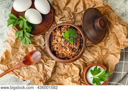A Pot Of Buckwheat Porridge And Boiled Eggs. Balanced Nutrition, Anti-crisis Food. Diet Healthy Lunc